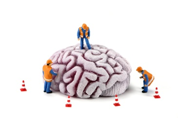 Brain with workers inspecting it. Mental Health concept