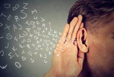 man holds hand near ear listens carefully alphabet letters flyin
